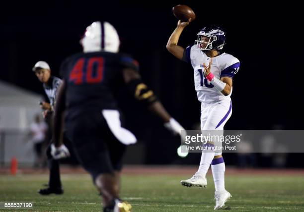 Gonzaga quarterback Caleb Williams makes a throw past DeMatha middle linebacker Mahlon Slaughter on October 06 2017 in Landover Maryland during a...