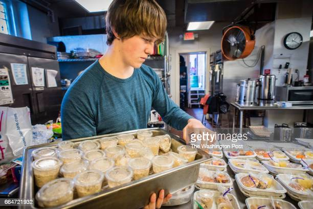 Gonzaga student Richard Hrdy a senior assembles lunches as part of the Campus Kitchen program Gonzaga High School students fulfill their service...