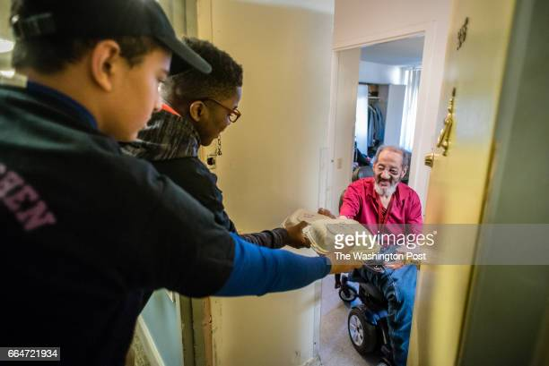 Gonzaga students Azariah Sheth and Derrick Aikens deliver lunches to Oscar Sparrow 68 Oscar a favorite of the students had been assaulted the...