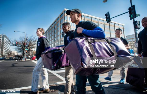 Gonzaga students from left Ryan Morahan Derrick Aikens Azariah Sheth Binh Ngo and Reggie Frost head over to Sibley Plaza to deliver lunches Gonzaga...