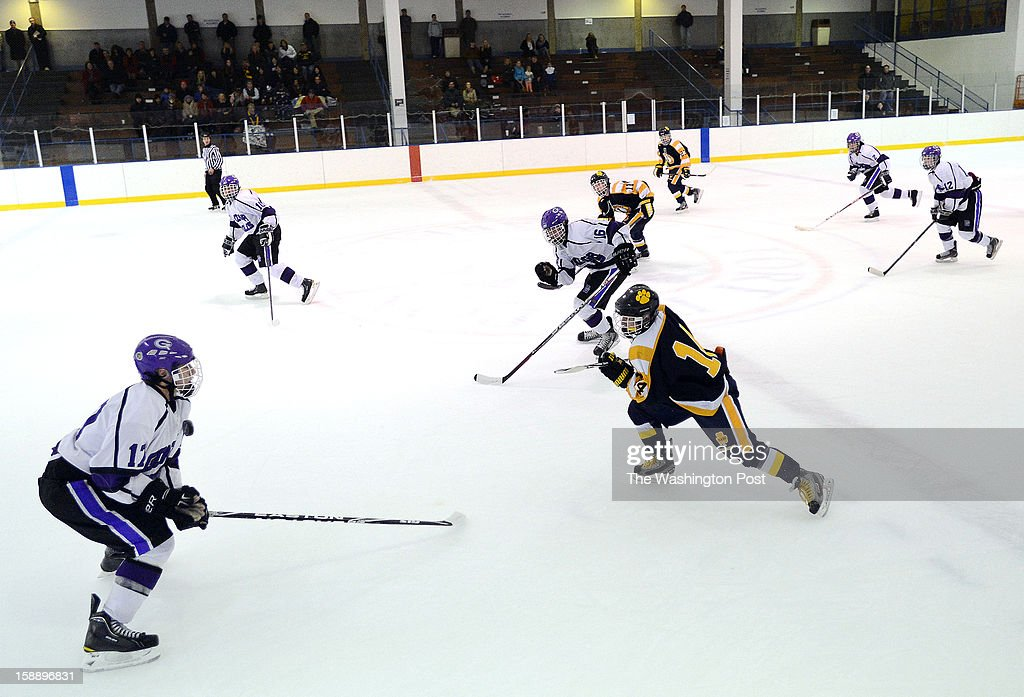 Gonzaga's Chris Meloni, left, blocks a pass with is chest during the championship game of the Purple Puck National Capital Hockey Tournament hosted by Gonzaga College High School on Monday, December 31, 2012. St. Ignatius (Cleveland, OH) defeated Gonzaga 2-1 for the title.