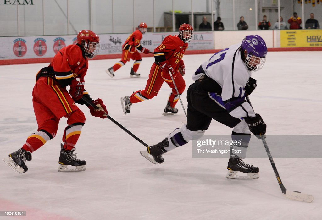 Gonzaga's Chris Meloni takes the puck down ice during the MAPHL Ice Hockey Championship at the Gardens Ice House in Laurel, Md., on Friday, February 22, 2013. Gonzaga defeated Calvert Hall 6-1 to win the title.