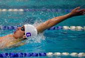 Gonzaga's Jase Ashkin wins the boys 100meter backstroke in the Washington Metropolitan Interscholastic Swimming and Diving Championships in...