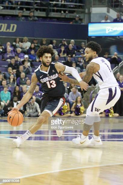 Gonzaga's Josh Perkins drives to the basket while being defended by Washington's David Crisp Gonzaga won 9770 over Washington on December 10 2017 at...