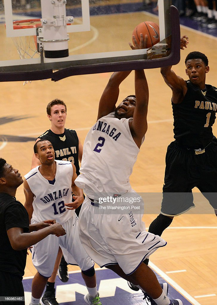 Gonzaga's Kris Jenkins gets fouled from behind by Paul VI's Franklin Howard during the game at Gonzaga College High School on Tuesday, January 29, 2013. Gonzaga defeated Paul VI 69-68.