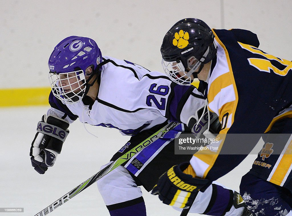 Gonzaga's Ridge Slater, left, skates past St. Ignatius's Beck Schultz during the championship game of the Purple Puck National Capital Hockey Tournament hosted by Gonzaga College High School on Monday, December 31, 2012. St. Ignatius (Cleveland, OH) defeated Gonzaga 2-1 for the title.