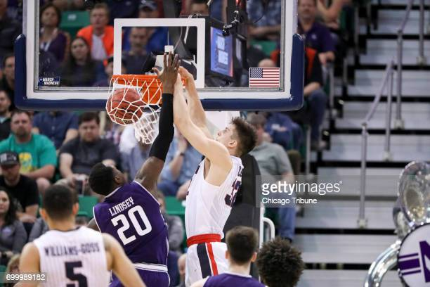Gonzaga's Zach Collins dunks over Northwestern's Scottie Lindsey in the second round of the NCAA Tournament at Vivint Smart Home Arena in Salt Lake...