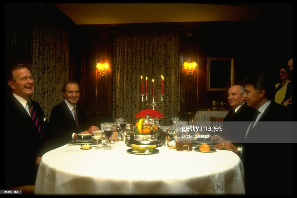 PM Gonzalez (R) hosting Pres. Bush (L) & Gorbachev (2nd fr. R), chatting over dinner on eve of Mideast peace conf., w. interpreter Palazhenko (rear L).