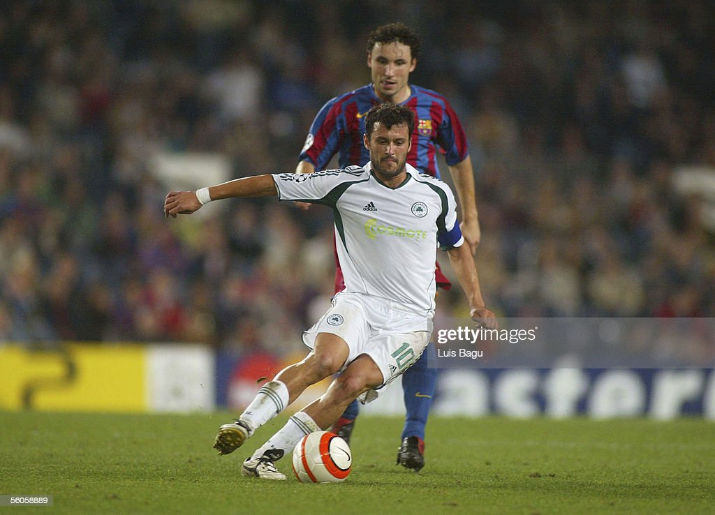 Gonzalez of Panatinhaikos and Van Bommel of FC Barcelona in action during the UEFA Champions League group C match between FC Barcelona and Panathinaikos at the Camp Nou stadium on November 2, 2005 in in Barcelona, Spain.