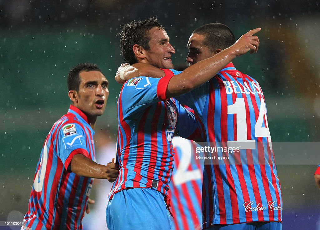 Gonzalo Bergessio of Catania celebrates with teammates after scoring his team's second goal during the Serie A match between Calcio Catania and Genoa...
