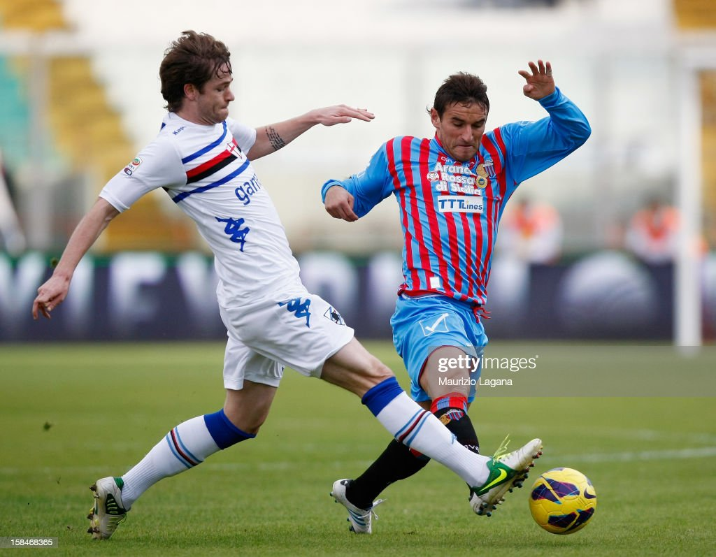 Gonzalo Bergessio of Catania competes for the ball with <a gi-track='captionPersonalityLinkClicked' href=/galleries/search?phrase=Jonathan+Rossini&family=editorial&specificpeople=5780827 ng-click='$event.stopPropagation()'>Jonathan Rossini</a> of Sampdoria during the Serie A match between Calcio Catania and UC Sampdoria at Stadio Angelo Massimino on December 16, 2012 in Catania, Italy.