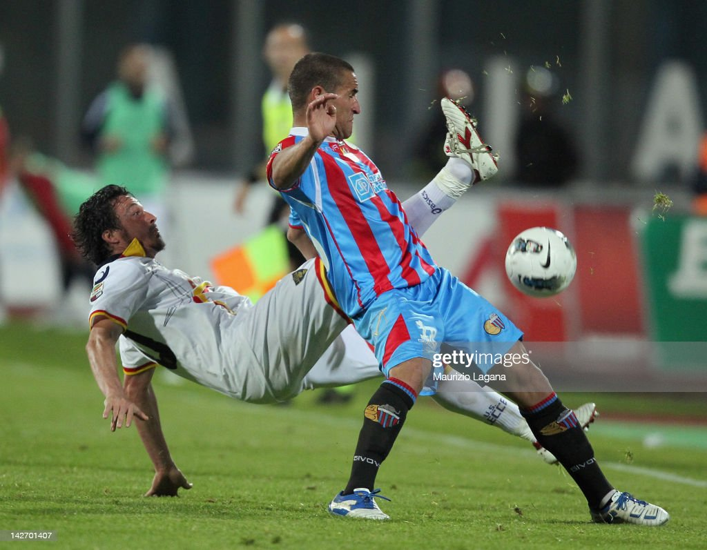 Gonzalo Bergessio of Catania competes for the ball with Massimo Oddo of Lecce during the Serie A match between Catania Calcio and US Lecce at Stadio...