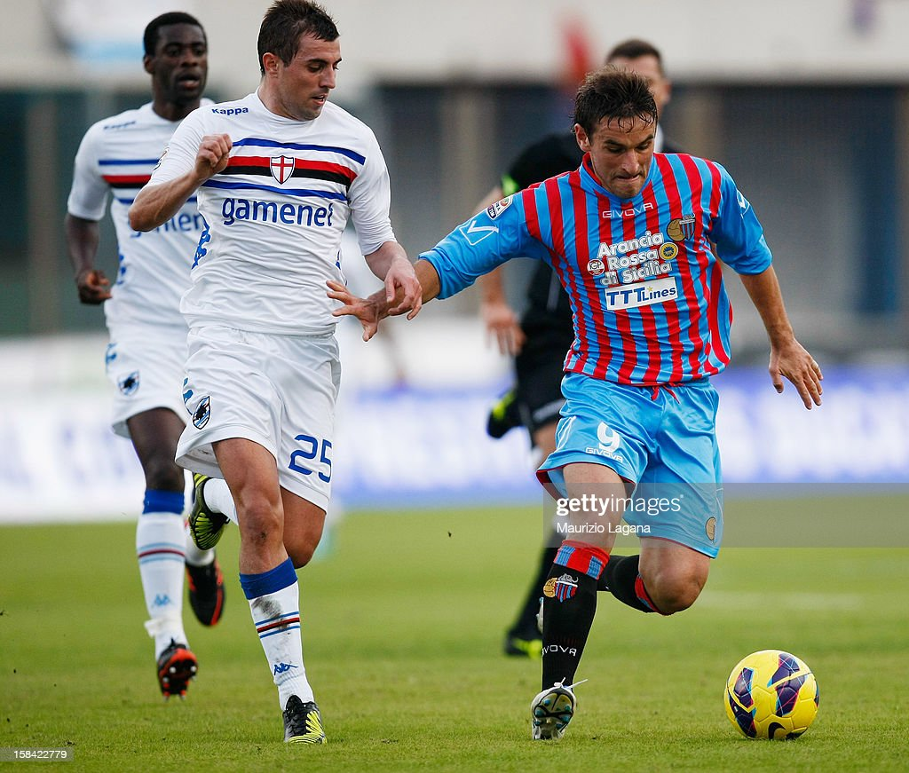 Gonzalo Bergessio (R) of Catania competes with Nenad Krsticic of UC Sampdoria during the Serie A match between Calcio Catania and UC Sampdoria at Stadio Angelo Massimino on December 16, 2012 in Catania, Italy.