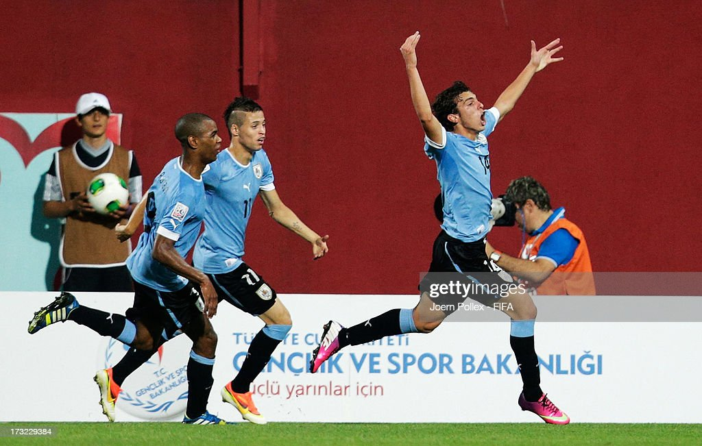 Gonzalo Bueno (R) of Uruguay celebrates with his team mates after scoring his team's first goal during the FIFA U-20 World Cup Semi Final match between Iraq and Uruguay at Huseyin Avni Aker Stadium on July 10, 2013 in Trabzon, Turkey.