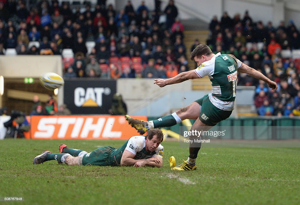 <a gi-track='captionPersonalityLinkClicked' href=/galleries/search?phrase=Gonzalo+Camacho&family=editorial&specificpeople=4218062 ng-click='$event.stopPropagation()'>Gonzalo Camacho</a> of Leicester Tigers holds the ball in the strong winds as <a gi-track='captionPersonalityLinkClicked' href=/galleries/search?phrase=Freddie+Burns&family=editorial&specificpeople=5075956 ng-click='$event.stopPropagation()'>Freddie Burns</a> of Leicester Tigers takes a penalty kick during the Aviva Premiership match between Leicester Tigers and Sale Sharks at Welford Road on February 6, 2016 in Leicester, England.