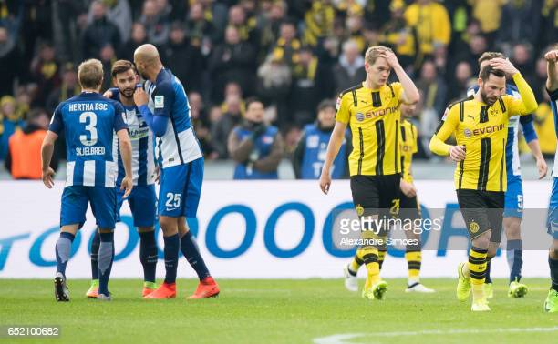 Gonzalo Castro and Matthias Ginter of Borussia Dortmund after receiving the goal to the 21 during the Bundesliga match between Hertha BSC and...