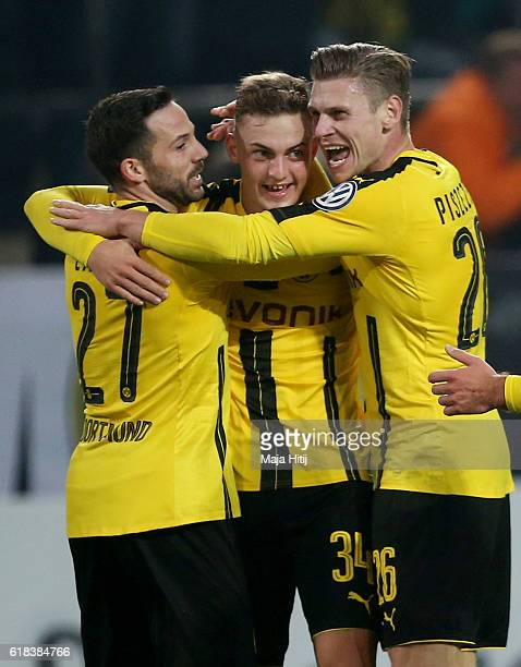 Gonzalo Castro Jacob Bruun Larsen and Lukasz Piszczek of Dortmund celebrate their opening goal during DFB Cup second round match between Borussia...