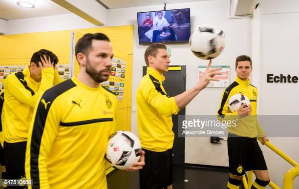 Gonzalo Castro Lukasz Piszczek and Julian Weigl of Borussia Dortmund at the mixed zone prior to the Bundesliga match between Borussia Dortmund and...