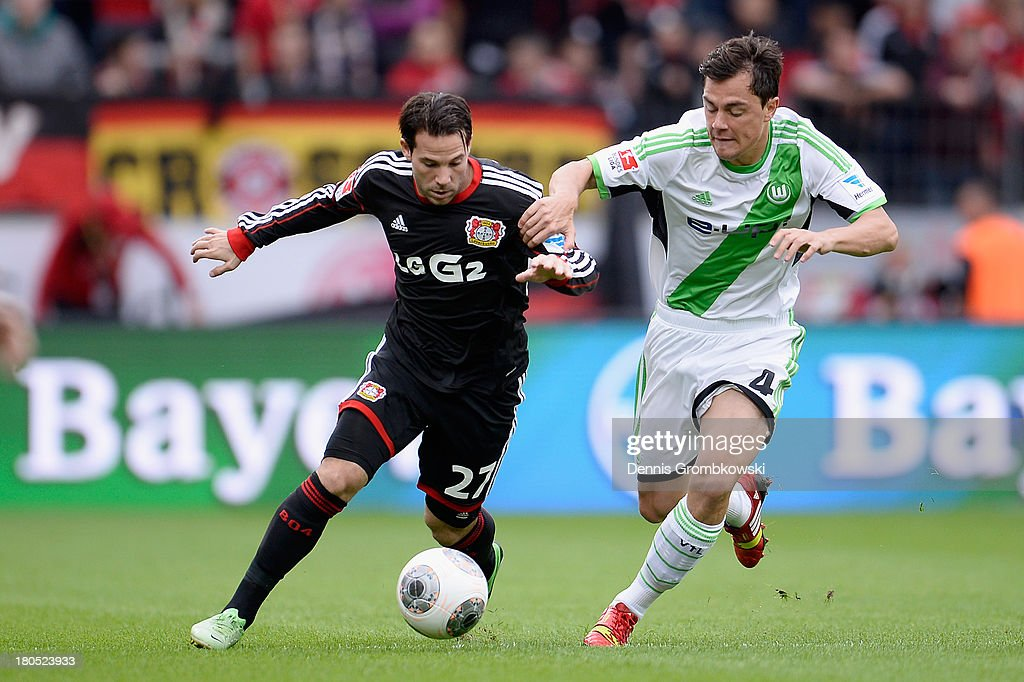<a gi-track='captionPersonalityLinkClicked' href=/galleries/search?phrase=Gonzalo+Castro&family=editorial&specificpeople=605388 ng-click='$event.stopPropagation()'>Gonzalo Castro</a> of Bayer Leverkusen and <a gi-track='captionPersonalityLinkClicked' href=/galleries/search?phrase=Marcel+Schaefer&family=editorial&specificpeople=656515 ng-click='$event.stopPropagation()'>Marcel Schaefer</a> of VfL Wolfsburg battle for the ball during the Bundesliga match between Bayer 04 Leverkusen and VfL Wolfsburg at BayArena on September 14, 2013 in Leverkusen, Germany.