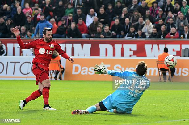 Gonzalo Castro of Bayer Leverkusen scores the fourth goal during the Bundesliga match between Bayer 04 Leverkusen and Hamburger SV at BayArena on...