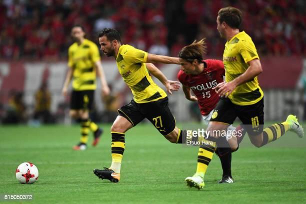 Gonzalo Castro of Borussia Dortmund and Kazuki Nagasawa of Urawa Red Diamonds compete for the ball during the preseason friendly match between Urawa...