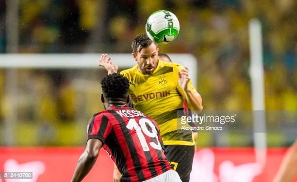 Gonzalo Castro of Borussia Dortmund challenges Franck Kessie of AC Milan during a preseason friendly match between AC Milan and Borussia Dortmund on...