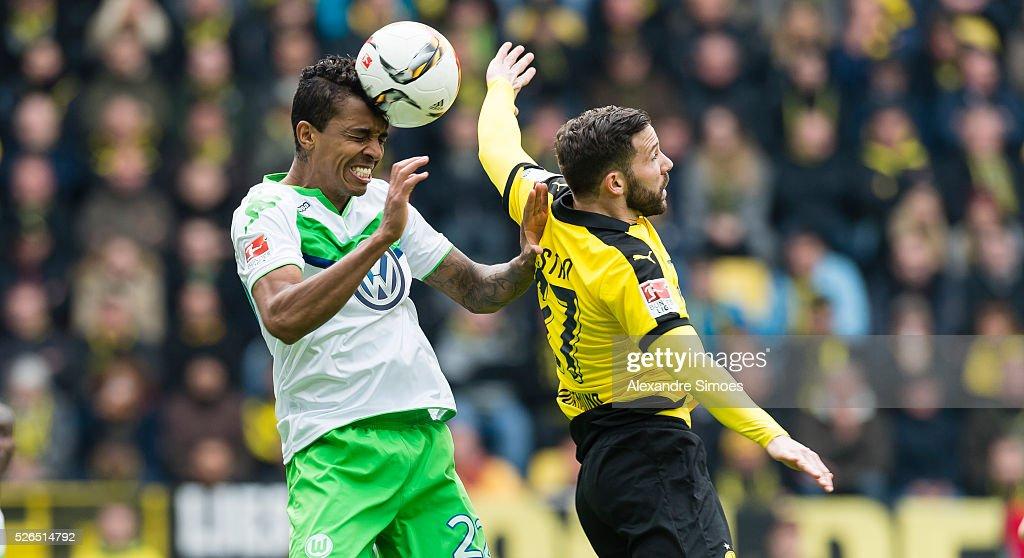 Gonzalo Castro of Borussia Dortmund challenges Luiz Gustavo of VfL Wolfsburg during the Bundesliga match between Borussia Dortmund and VfL Wolfsburg at Signal Iduna Park on April 30, 2016 in Dortmund, Germany.