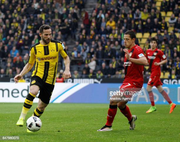 Gonzalo Castro of Borussia Dortmund in action with Chicharito of Bayer 04 Leverkusen during the Bundesliga soccer match between Borussia Dortmund and...