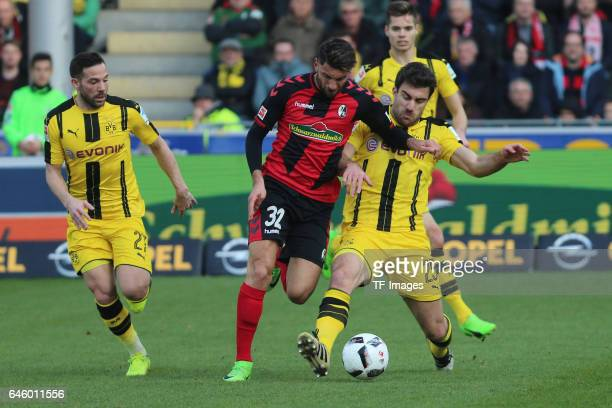 Gonzalo Castro of Borussia Dortmund Vincenzo Grifo of Freiburg Sokratis Papastathpoulos of Dortmund battle for the ball during the Bundesliga match...
