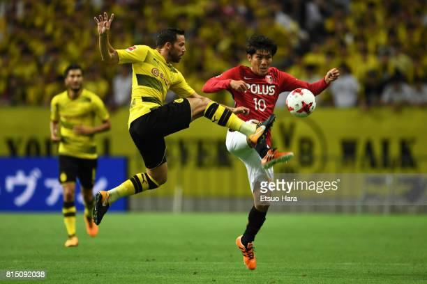 Gonzalo Castro of Burussia Dortmund and Yosuke Kashiwagi of Urawa Red Diamonds compete for the ball during the preseason friendly match between Urawa...