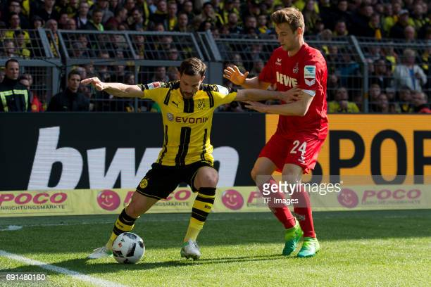 Gonzalo Castro of Dortmund and Lukas Kluenter of Colonge battle for the ball during the Bundesliga match between Borussia Dortmund and FC Koeln at...