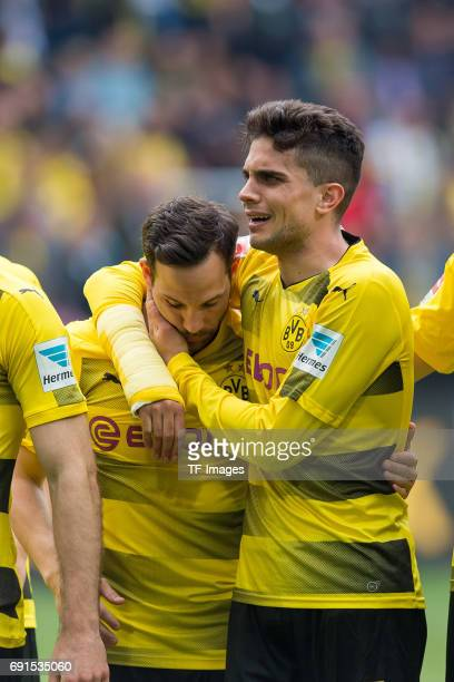 Gonzalo Castro of Dortmund and Marc Bartra of Dortmund celebrate their win during the Bundesliga match between Borussia Dortmund and Werder Bremen at...