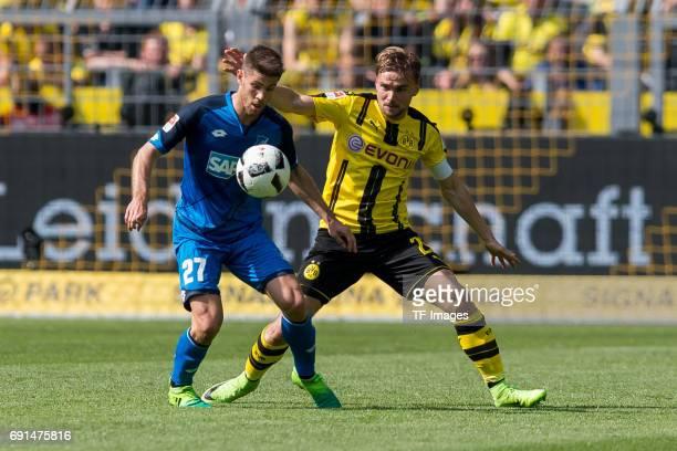 Gonzalo Castro of Dortmund and Marcel Schmelzer of Dortmund battle for the ball during the Bundesliga match between Borussia Dortmund and TSG 1899...