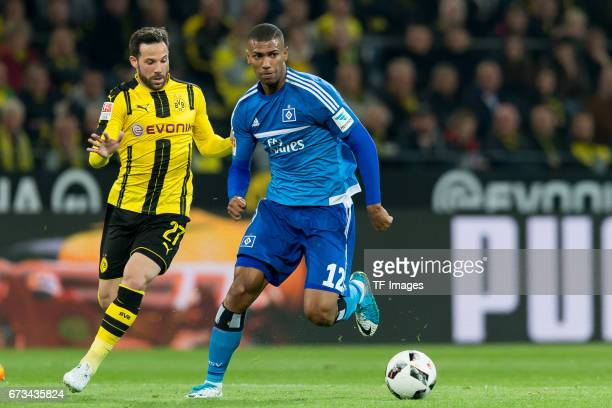 Gonzalo Castro of Dortmund and Walace of Hamburg controls the ball during the Bundesliga match between Borussia Dortmund and Hamburger SV at Signal...
