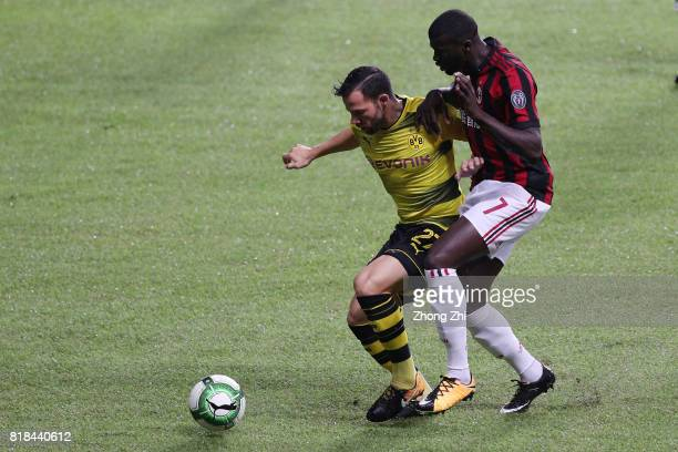 Gonzalo Castro of Dortmund in action against M'Baye Niang of AC Milan during the 2017 International Champions Cup football match between AC Milan and...