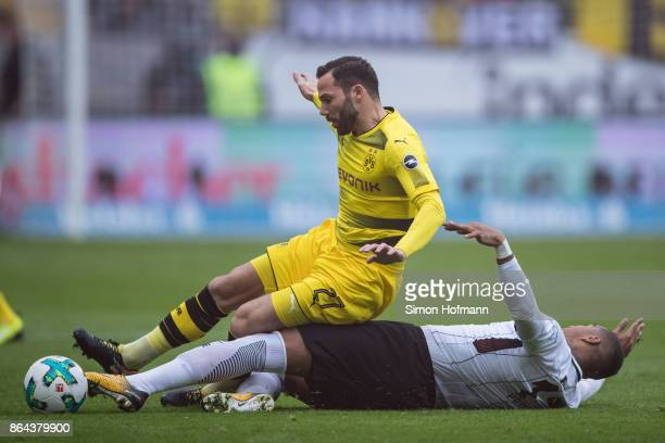 Gonzalo Castro of Dortmund is tackled by KevinPrince Boateng of Frankfurt during the Bundesliga match between Eintracht Frankfurt and Borussia...