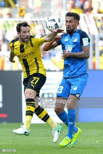 Gonzalo Castro of Dortmund Kerem Demirbay of Hoffenheim battle for the ball during the Bundesliga match between Borussia Dortmund and TSG 1899...