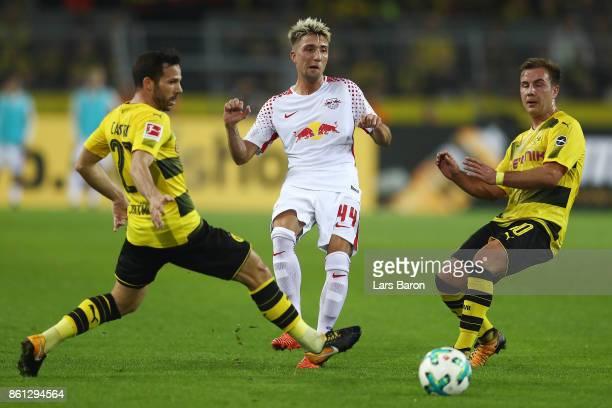 Gonzalo Castro of Dortmund Kevin Kampl of Leipzig and Mario Goetze of Dortmund during the Bundesliga match between Borussia Dortmund and RB Leipzig...