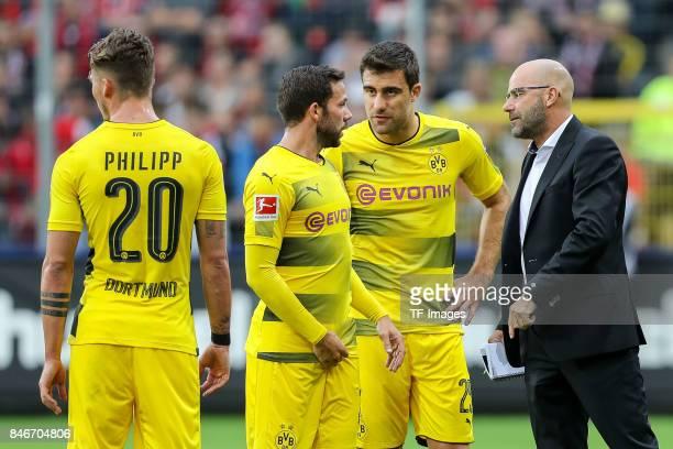 Gonzalo Castro of Dortmund Sokratis of Dortmund speak with Head coach Peter Bosz of Dortmund during the Bundesliga match between SportClub Freiburg...