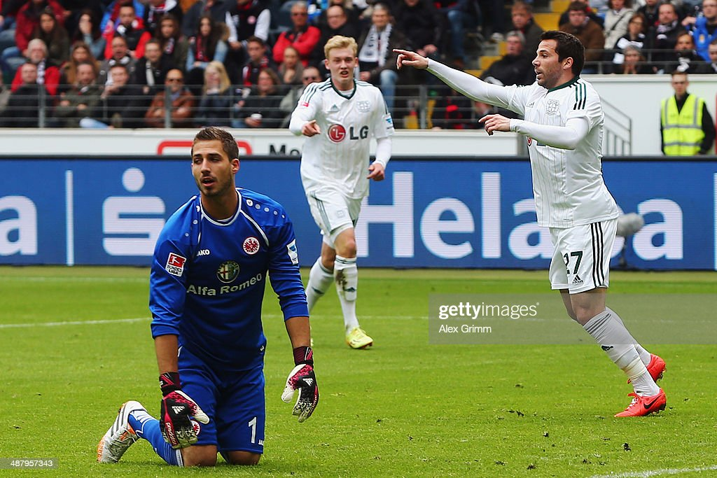 <a gi-track='captionPersonalityLinkClicked' href=/galleries/search?phrase=Gonzalo+Castro&family=editorial&specificpeople=605388 ng-click='$event.stopPropagation()'>Gonzalo Castro</a> (R) of Leverkusen celebrates his team's first goal as goalkeeper <a gi-track='captionPersonalityLinkClicked' href=/galleries/search?phrase=Kevin+Trapp&family=editorial&specificpeople=4409868 ng-click='$event.stopPropagation()'>Kevin Trapp</a> of Frankfurt reacts during the Bundesliga match between Eintracht Frankfurt and Bayer Leverkusen at Commerzbank Arena on May 3, 2014 in Frankfurt am Main, Germany.