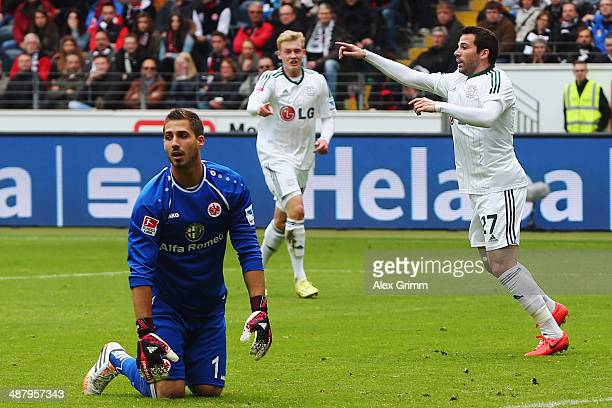 Gonzalo Castro of Leverkusen celebrates his team's first goal as goalkeeper Kevin Trapp of Frankfurt reacts during the Bundesliga match between...