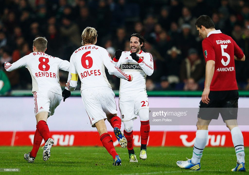 <a gi-track='captionPersonalityLinkClicked' href=/galleries/search?phrase=Gonzalo+Castro&family=editorial&specificpeople=605388 ng-click='$event.stopPropagation()'>Gonzalo Castro</a> (2nd R) of Leverkusen celebrates with his team mates after scoring his team's first goal during the Bundesliga match between Hannover 96 and Bayer 04 Leverkusen at AWD Arena on December 9, 2012 in Hannover, Germany.