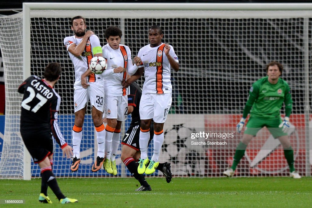 <a gi-track='captionPersonalityLinkClicked' href=/galleries/search?phrase=Gonzalo+Castro&family=editorial&specificpeople=605388 ng-click='$event.stopPropagation()'>Gonzalo Castro</a> (L) of Leverkusen fires a free-kick into the wall during the UEFA Champions League Group A match between Bayer Leverkusen and Shakhtar Donetsk at BayArena on October 23, 2013 in Leverkusen, Germany.
