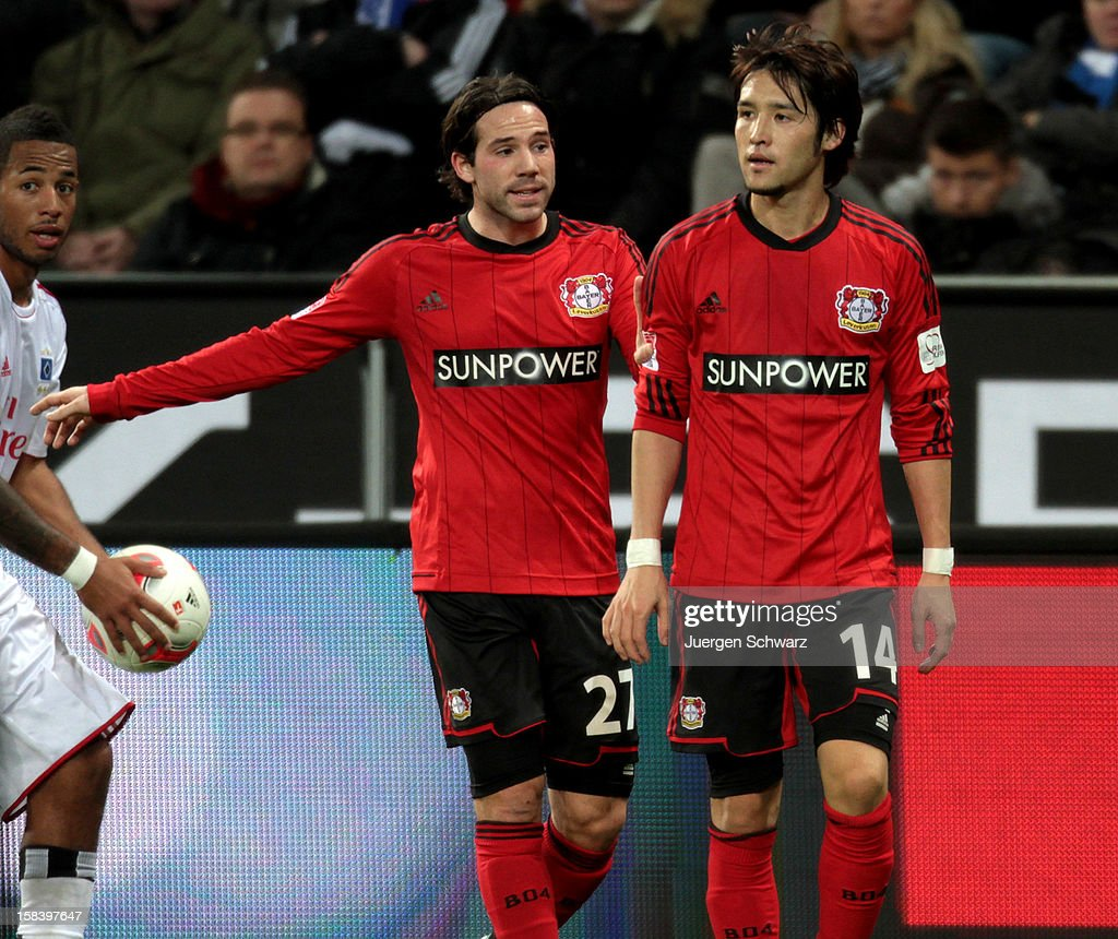 <a gi-track='captionPersonalityLinkClicked' href=/galleries/search?phrase=Gonzalo+Castro&family=editorial&specificpeople=605388 ng-click='$event.stopPropagation()'>Gonzalo Castro</a> (L) of Leverkusen gestures beside <a gi-track='captionPersonalityLinkClicked' href=/galleries/search?phrase=Hajime+Hosogai&family=editorial&specificpeople=4023693 ng-click='$event.stopPropagation()'>Hajime Hosogai</a> during the Bundesliga match between Bayer Leverkusen and Hamburger SV at BayArena on December 15, 2012 in Leverkusen, Germany.