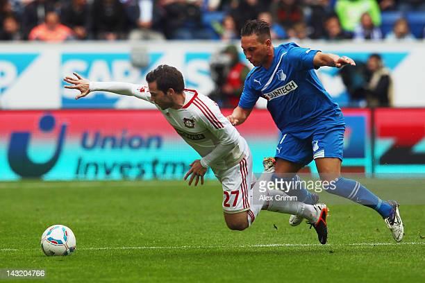 Gonzalo Castro of Leverkusen is challenged by Tobias Weis of Hoffenheim during the Bundesliga match between 1899 Hoffenheim and Bayer 04 Leverkusen...