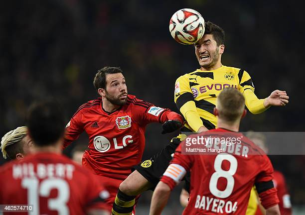Gonzalo Castro of Leverkusen jumps for a header with Nuri Sahin of Dortmund during the Bundesliga match between Bayer 04 Leverkusen and Borussia...