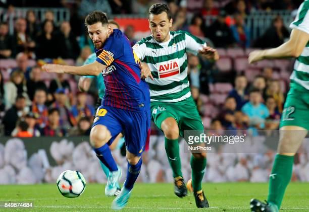 Gonzalo Escalante and Leo Messi during La Liga match between FC Barcelona v SC Eibar in Barcelona on September 19 2017