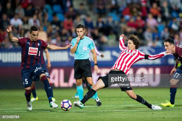 Gonzalo Escalante of SD Eibar duels for the ball with Ander Iturraspe of Athletic Club during the La Liga match between SD Eibar and Athletic Club at...