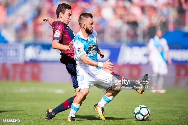 Gonzalo Escalante of SD Eibar duels for the ball with Emre Colak of RC Deportivo La Coruna during the La Liga match between SD Eibar and RC Deportivo...