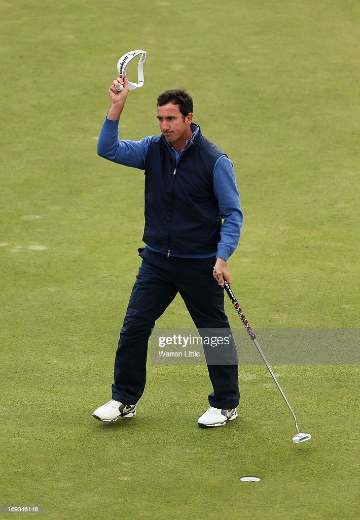 Gonzalo Fdez-Castano of Spain acknowledges the crowd on the 18th green during the first round of the BMW PGA Championship on the West Course at Wentworth on May 23, 2013 in Virginia Water, England.